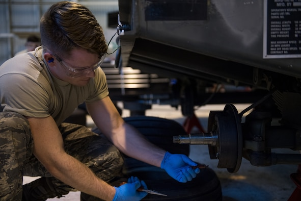 Airman 1st Class Jerrick Worley, 2nd Munitions Squadron munitions systems equipment maintenance crew chief, replaces a spring on a MHU-110 munitions trailer at RAF Fairford, England, April 2, 2019. Fairford has more than 35 munitions trailers on base and 2nd MUNS Airmen have been able to return more than 15 of them to serviceability. (U.S. Air Force photo by Airman 1st Class Tessa B. Corrick)