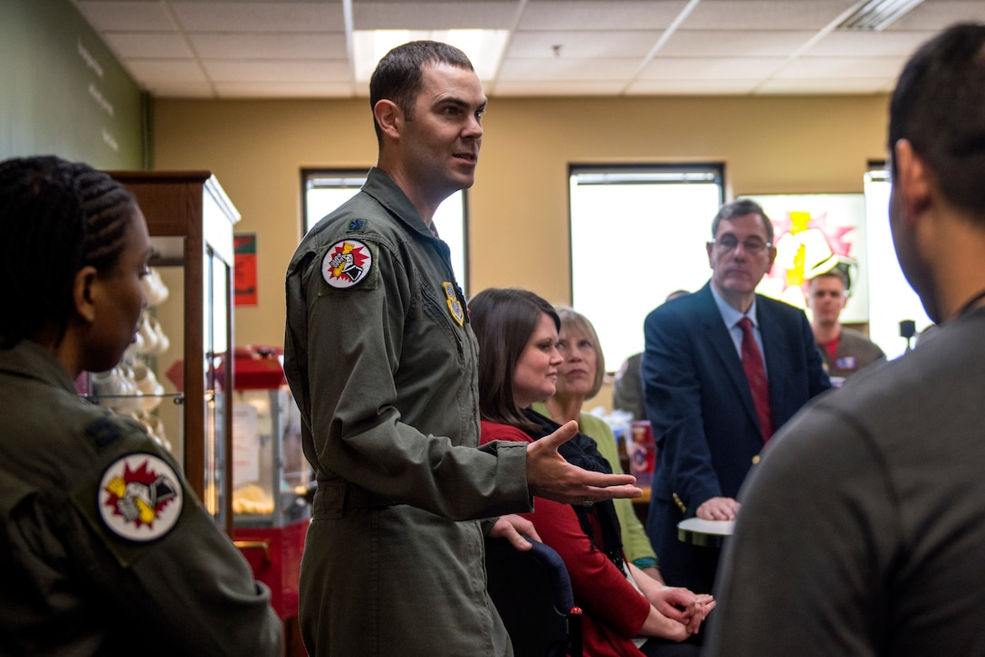 "U.S. Air Force Lt. Col. Kevin Parsons, 93rd Air Refueling Squadron commander, shares ""war stories"" with fellow Airmen during a celebration of the squadron's 70th anniversary at Fairchild Air Force Base, Washington, March 29, 2019. Although the 93rd is not a frontline fighter squadron, it has proven to be a vital component in fueling the fight for 70 years and helped train all subsequent refueling units. (U.S. Air Force photo by Airman 1st Class Whitney Laine)"
