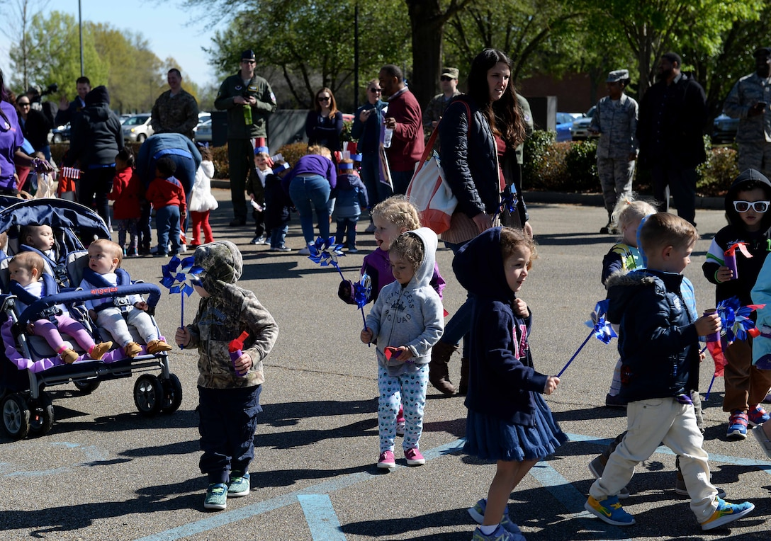 Children from the Child Development Center march in the Month of the Military Child parade April 1, 2019, on Columbus Air Force Base, Miss. The month of April is set aside every year as a time to honor and recognize the sacrifices made by military families worldwide, with an emphasis on dependent children whom experience military family members serving at home and overseas. (U.S. Air Force photo by Airman Hannah Bean)