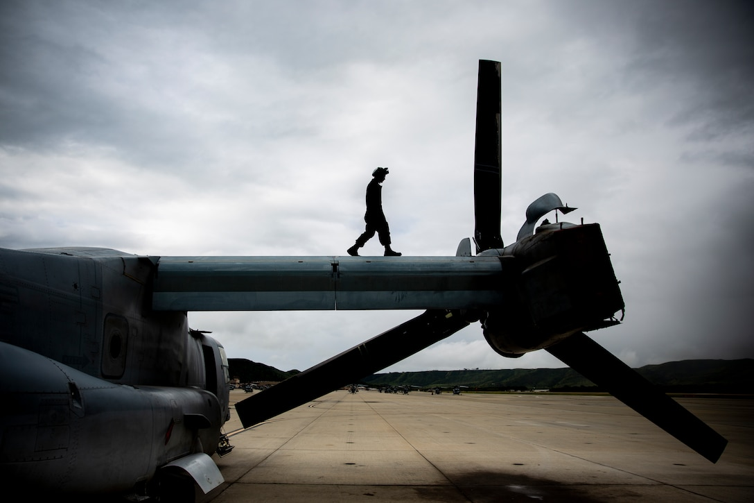U.S. Marine Corps Lance Cpl. Austin Wright, tiltrotor airframe mechanic, Marine Medium Tiltrotor Squadron 164, Marine Aircraft Group 39, 3rd Marine Aircraft Wing, walks across the wing of an MV-22 Osprey aircraft at Marine Corps Air Station Camp Pendleton, California, April 4, 2019. Maintenance is performed around-the-clock to ensure aircraft operating out of MCAS Camp Pendleton are at maximum readiness for future flight operations.