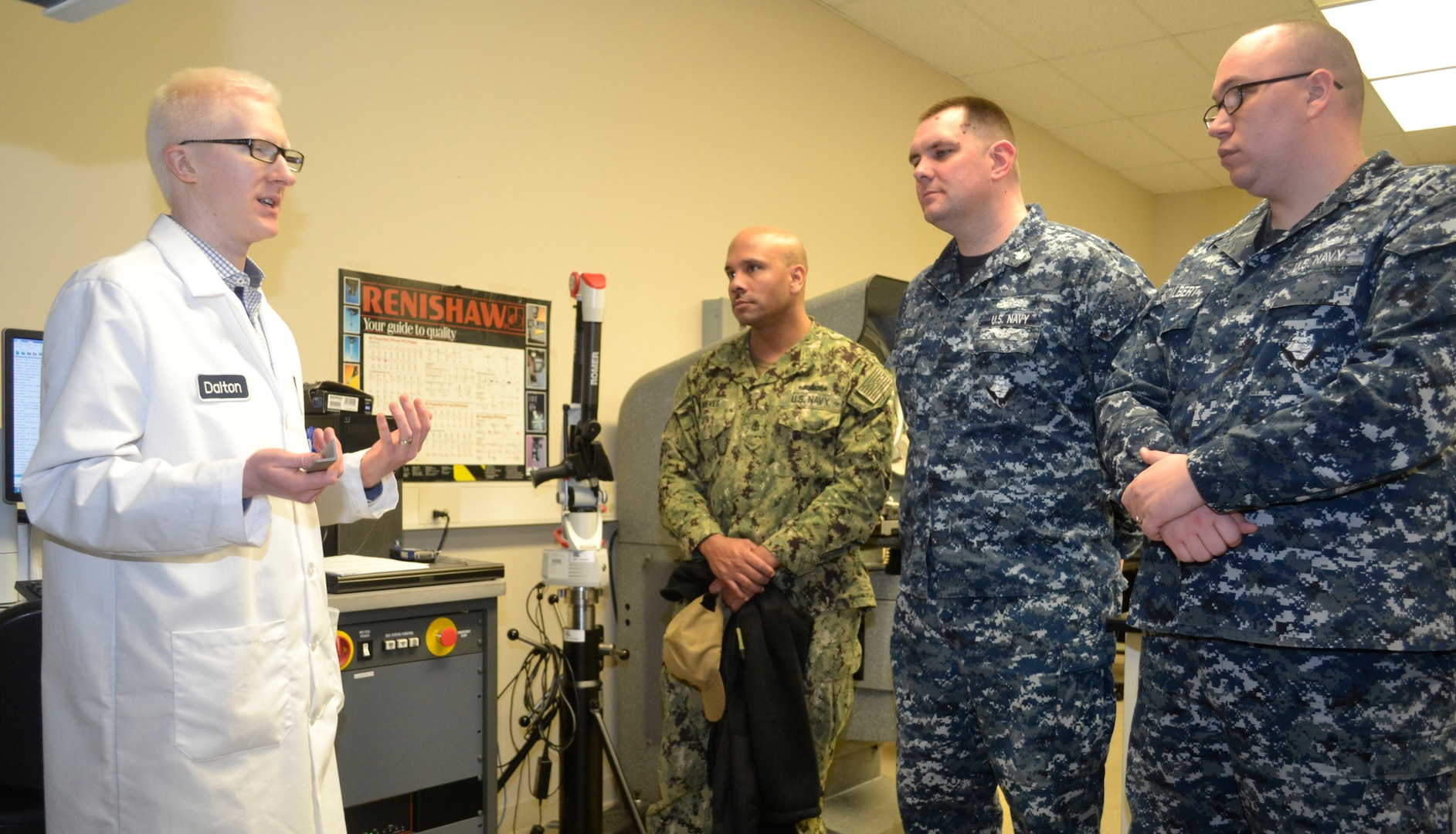 DLA Troop Support Product Test Center Analytical engineer Edward Dalton, far left, explains a PTC-A testing process for reflectivity of materials to a group of sailors assigned to Naval Support Activity Philadelphia April 3, 2019 in Philadelphia.