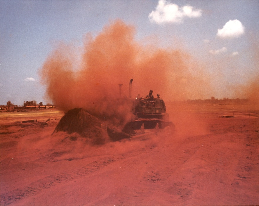 Red dust kicked up by bulldozer