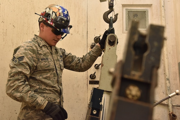 Senior Airman Steven Navarro, 741st Maintenance Squadron mechanical and pneudraulics section team chief, hooks a hoist from a payload transporter to a tensioner March 18, 2019, at Malmstrom Air Force Base, Mont.