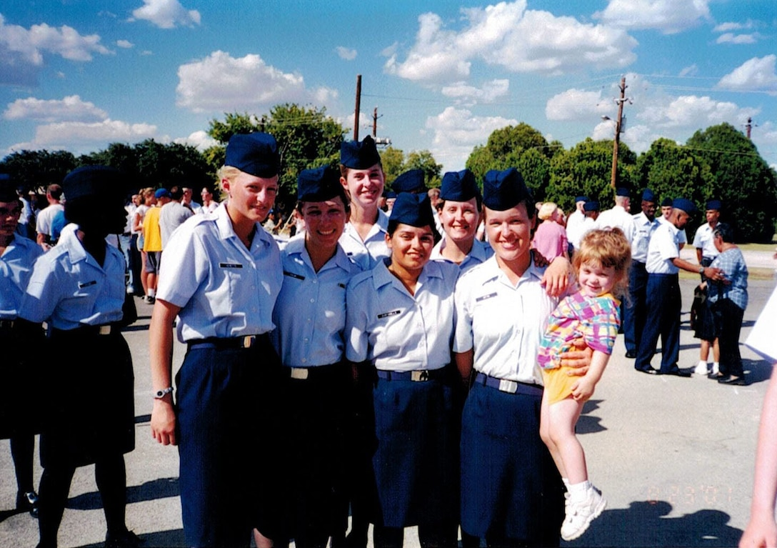 U.S. Air Force Chief Master Sgt. Andrea Inmon, 92nd Operations Group chief enlisted manager, poses for photo with Airmen from her basic military training flight after graduation. Inmon initially joined the Air Force in July 2001 for G.I. Bill benefits and to travel the world, but chose to make it a career when she discovered a new appreciation for her country and the men and women serving alongside her. (Courtesy Photo)