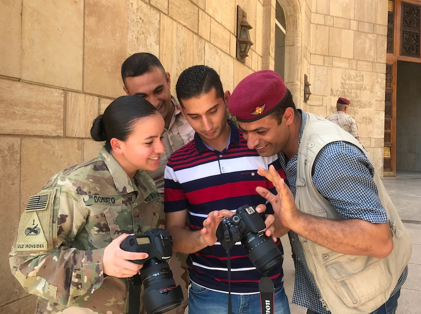 Sgt. Von Marie Donato, a public affairs non-commissioned officer assigned to Combined Joint Forces Land Component Command – Operation Inherent Resolve and 1st Armored Division, provides media and photography training to Iraqi security forces and media personnel at the Baghdad Operations Center in Baghdad, Iraq, Aug. 21, 2017. CJFLCC-OIR is a Coalition of 23 regional and international nations which have joined together to enable partnered forces to defeat ISIS in Iraq and restore stability and security.