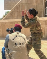 Sgt. Von Marie Donato, a public affairs non-commissioned officer assigned to Combined Joint Forces Land Component Command – Operation Inherent Resolve and 1st Armored Division, provides media and photography training to an Iraqi security forces member at the Baghdad Operations Center in Baghdad, Iraq, Aug. 21, 2017. CJFLCC-OIR is a Coalition of 23 regional and international nations which have joined together to enable partnered forces to defeat ISIS in Iraq and restore stability and security.