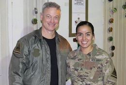 Actor Gary Sinise conducts a meet and greet with Sgt. Von Marie Donato, a public affairs non-commissioned officer assigned to Combined Joint Forces Land Component Command – Operation Inherent Resolve and 1st Armored Division, as he visits service members in Baghdad, Iraq, Dec. 20, 2017. The visit was part of a United Service Organization entertainment tour to promote morale and support military members.