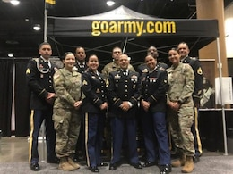 (Pictured Center) Sgt. 1st Class Leonel Castillo, a U.S. Army recruiter with the Kissimmee Recruiting Office, Tampa Recruiting Battalion, 2nd Recruiting Brigade, United States Recruiting Command, and (pictured left of Castillo) Sgt. Von Marie Donato, a Special Recruiter Assistance Program participant and a public affairs specialist assigned to U.S. Army Central, pose for a group photo along with other SRAP participants at the Tom Joyner Family Reunion Convention Show in Orlando, FL at the Gaylord Palms Resort Aug. 31, 2017.