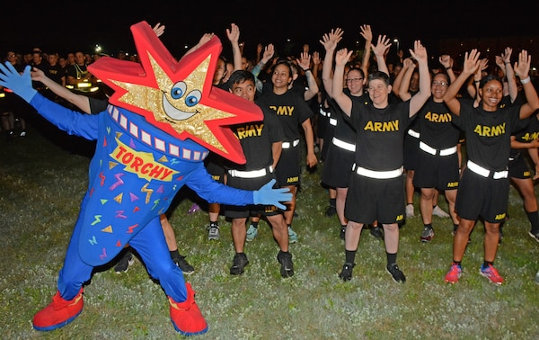 """Torchy,"" the official mascot for the Fiesta Flambeau® Parade Association, shines at the Health Readiness Center of Excellence 2019 Viva Fiesta Fun Run on Fort Sam Houston."