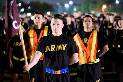 Soldiers assigned to the Health Readiness Center of Excellence stand at ease in formation prior to the pre-dawn 2019 Viva Fiesta Fun Run at Joint Base San Antonio-Fort Sam Houston April 5.