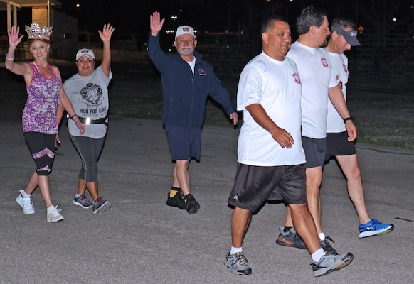 Fiesta Commission members walk to the start line for the two mile Health Readiness Center of Excellence 2019 Viva Fiesta Fun Run at Joint Base San Antonio-Fort Sam Houston April 5.