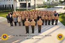 Marines at U.S. Marine Corps Forces, South stand at attention for a group photo, March 1, 2019.