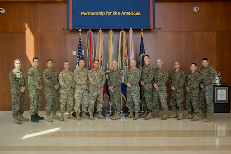 U.S. Marines and Chilean Marines pose for a group photo at U.S. Marine Corps Forces, South, March 4, 2019.