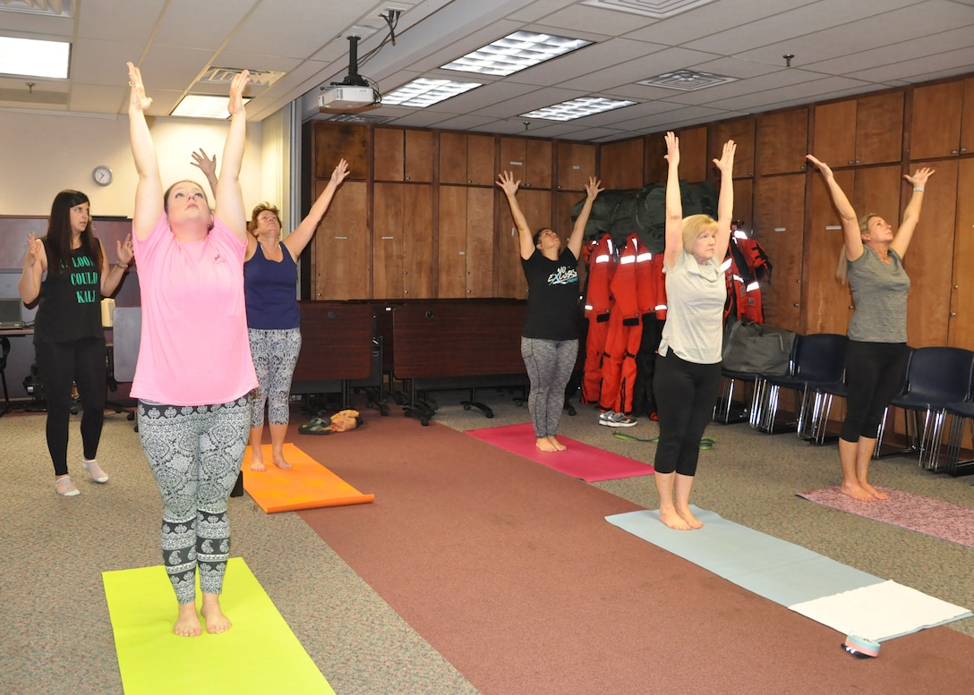 Savannah District Realty Specialist and Certified Yoga Instructor Emily Jimmo, instructs district team members during yoga class. Jimmo voluntarily teaches the class once a week, during lunch, to help promote a healthy, less stressful work atmosphere.