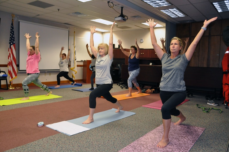 Helpdesk IT Specialist Dawn Ratner performs a yoga bow pose. Ratner is one of 24 Savannah District employees who participate in the class during lunch.