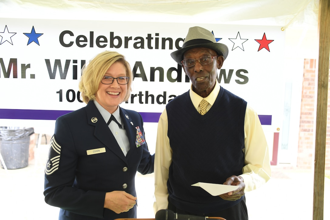 Willis Andrews, former aviation engineer under Eighth Air Force and World War II veteran, is presented two Eighth Air Force coins and a letter of appreciation by Chief Master Sgt. Shelley Cohen, 8th Air Force command chief IMA, during his 100th birthday celebration in Truxno, La., March 30, 2019. Andrews spent three years overseas during World War II serving in France, Germany and England. (U.S. Air Force photo by Senior Airman Luke Hill)