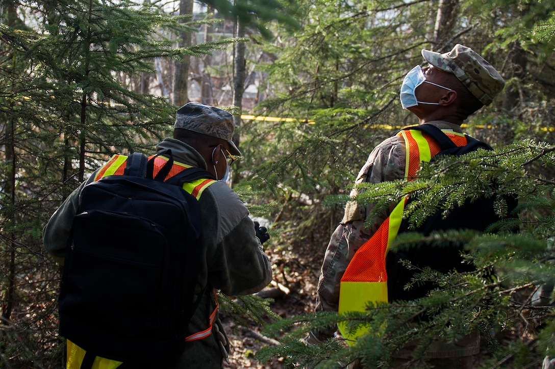 U.S. Air Force Senior Airman Jeremy Bennett with the 673d Force Support Squadron scans the trees during a search and recovery mission for mortuary affairs training during Polar Force 19-4 at Joint Base Elmendorf-Richardson, Alaska, April 2, 2019. Polar Force is a two-week exercise designed to test JBER's mission readiness, and strengthen and develop the skills service members require when facing adverse situations.