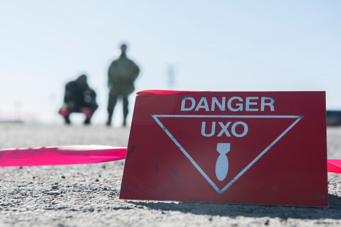 Danger signs surround an unexploded ordnance during exercise Polar Force at Joint Base Elmendorf-Richardson, Alaska, April 3, 2019. Polar Force is a two-week exercise designed to test JBER's mission readiness, and develops the skills service members require to face adverse situations.