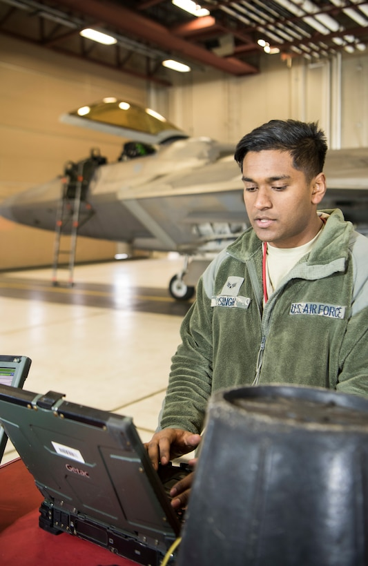 U.S. Air Force Senior Airman Dallas Singh, 90th Aircraft Maintenance Unit assistant dedicated crew chief, goes through technical orders during Polar Force 19-4 at Joint Base Elmendorf-Richardson, Alaska, April 3, 2019. Polar Force is a two-week exercise designed to test JBER's mission readiness, and develops the skills service members require to face adverse situations.