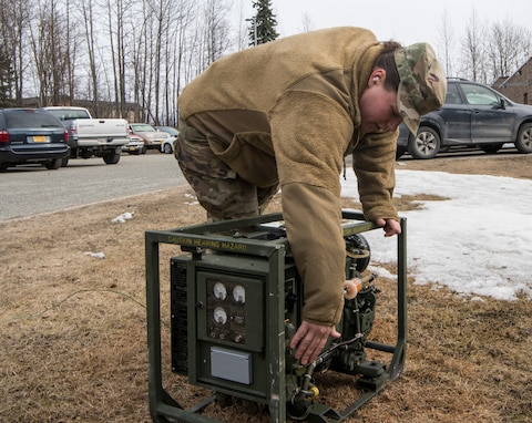 U.S. Air Force Staff Sgt. Danielle Shively, 673d Force Support Squadron unit deployment manager, operates a generator during Polar Force 19-4 at Joint Base Elmendorf-Richardson, Alaska, April 4, 2019. Polar Force is a two-week exercise designed to test JBER's mission readiness, and develops the skills service members require to face adverse situations.