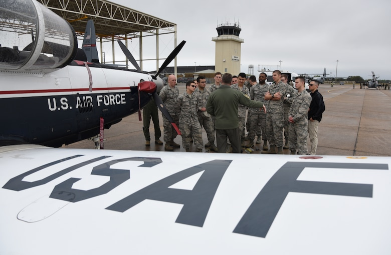 U.S. Air Force Maj. Thomas Martin, 37th Flying Training Squadron instructor pilot, Columbus Air Force Base, Mississippi, briefs Air Force ROTC cadets on a T-6 Texan II static display during the fifth annual Pathways to Blue on Keesler Air Force Base, Mississippi, April 5, 2019. Pathways to Blue is a diversity outreach event hosted by Second Air Force with the support of the 81st Training Wing and the 403rd Wing. More than 250 cadets from 12 different colleges and universities were provided hands-on demonstrations of various career fields. (U.S. Air Force photo by Kemberly Groue)