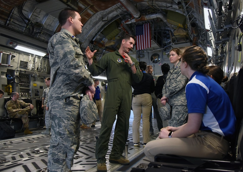 U.S. Air Force Capt. Andrew Mazzarelli, 58th Airlift Squadron tactics flight commander, Altus Air Force Base, Oklahoma, briefs on the capabilities of a C-17 Globemaster III to Air Force ROTC cadets during the fifth annual Pathways to Blue on Keesler Air Force Base, Mississippi, April 5, 2019. Pathways to Blue is a diversity outreach event hosted by Second Air Force with the support of the 81st Training Wing and the 403rd Wing. More than 250 cadets from 12 different colleges and universities were provided hands-on demonstrations of various career fields. (U.S. Air Force photo by Kemberly Groue)