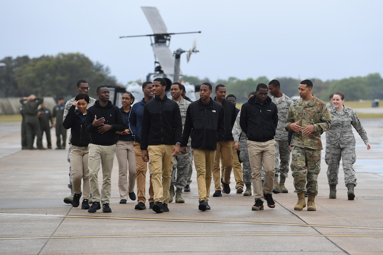 Air Force ROTC cadets walk across the flight line during the fifth annual Pathways to Blue on Keesler Air Force Base, Mississippi, April 5, 2019. Pathways to Blue is a diversity outreach event hosted by Second Air Force with the support of the 81st Training Wing and the 403rd Wing. More than 250 cadets from 12 different colleges and universities were provided hands-on demonstrations of various career fields. (U.S. Air Force photo by Kemberly Groue)