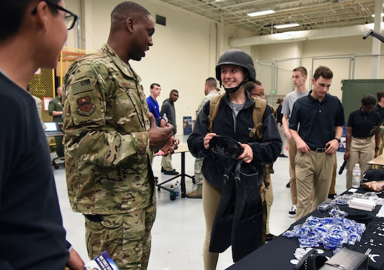 U.S Air Force Tech. Sgt. Cornelius Bostic, 330th Special Warfare Recruiting Squadron recruiter, briefs Claire Stewart, University of Houston Air Force ROTC cadet, on equipment worn by special operations members during the fifth annual Pathways to Blue on Keesler Air Force Base, Mississippi, April 5, 2019. Pathways to Blue is a diversity outreach event hosted by Second Air Force with the support of the 81st Training Wing and the 403rd Wing. More than 250 cadets from 12 different colleges and universities were provided hands-on demonstrations of various career fields. (U.S. Air Force photo by Kemberly Groue)