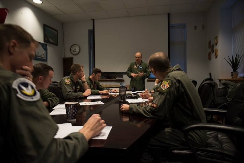 Image of Lt. Col. Thomas Bean, 366th Fighter Wing Inspector General and F-15E instructor pilot, briefs pilots before a flight April 3, 2019, at Mountain Home Air Force Base, Idaho. The pilots are participants of Gunfighter Flag, a quarterly exercise designed to strengthen and combine mission capabilities. (U.S. Air Force photo by Senior Airman Alaysia Berry)