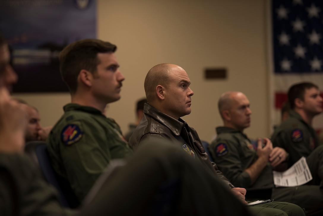 Image of Lt. Col. Thomas Bean, 366th Fighter Wing Inspector General and F-15E instructor pilot, listens to a briefing before a flight April 3, 2019, at Mountain Home Air Force Base, Idaho. Before flying pilots spend hours mission planning and attend multiple briefings. (U.S. Air Force photo by Senior Airman Alaysia Berry)