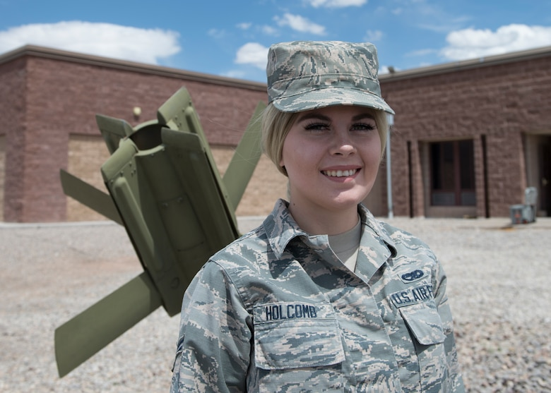 Airman 1st Class Alicia Holcomb, 49th Equipment Maintenance Squadron's munitions systems specialist, poses for a photo on Holloman Air Force Base, N.M. Airman 1st Class Alicia Holcomb, 49th Equipment Maintenance Squadron's munitions systems specialist, poses for a photo on Holloman Air Force Base, N.M. Holcomb's journey with Holloman's Alcohol and Drug Abuse and Prevention Treatment program has not been perfect, but she continues to persevere in times of weakness so she can complete her program this summer. (U.S. Air Force photo by Airman 1st Class Kindra Stewart)