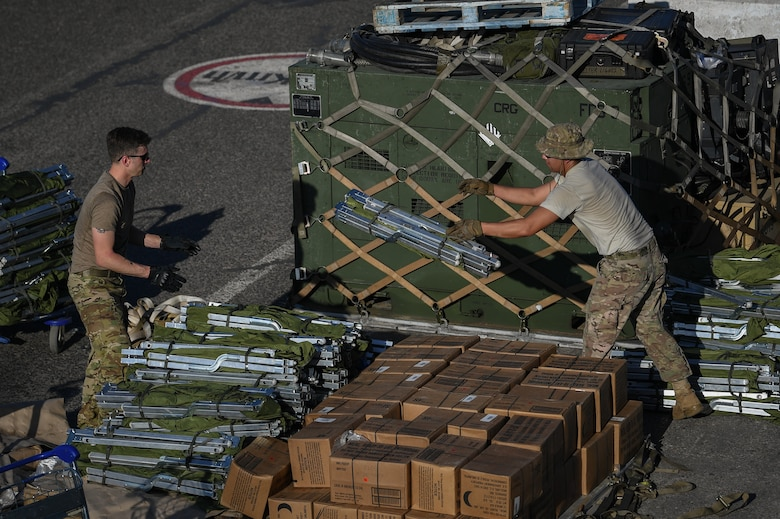 U.S. Airmen assigned to the 435th Contingency Response Group, Ramstein Air Base, Germany, supporting Combined Joint Task Force-Horn of Africa (CJTF-HOA), set up a forward operating location at Beira Airport, Mozambique, April 2, 2019, for the U.S. Department of Defense's (DoD) relief effort in the Republic of Mozambique and surrounding areas following Cyclone Idai. Teams from CJTF-HOA, which is leading DoD support to relief efforts in Mozambique, began immediate preparation to respond following a call for assistance from the U.S. Agency for International Development's Disaster Assistance Response Team. (U.S. Air Force photo by Staff Sgt. Corban Lundborg)