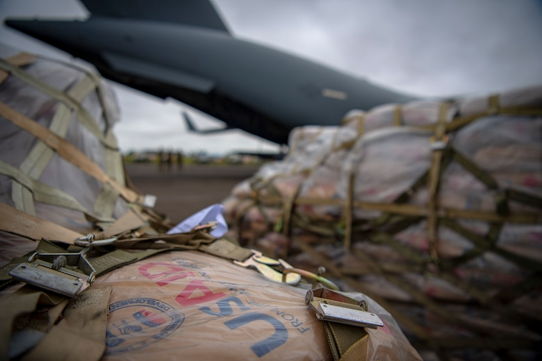 A U.S. Air Force C-17 Globemaster III assigned to Joint Base Lewis-McChord, Washington, supporting Combined Joint Task Force-Horn of Africa, delivers food aid from the United States Agency for International Development (USAID) in Maputo, Mozambique, April 2, 2019. The task force is helping meet requirements identified by USAID assessment teams and humanitarian organizations working in the region by providing logistics support and manpower to USAID at the request of the Government of the Republic of Mozambique. (U.S. Air Force Photo by Tech. Sgt. Chris Hibben)