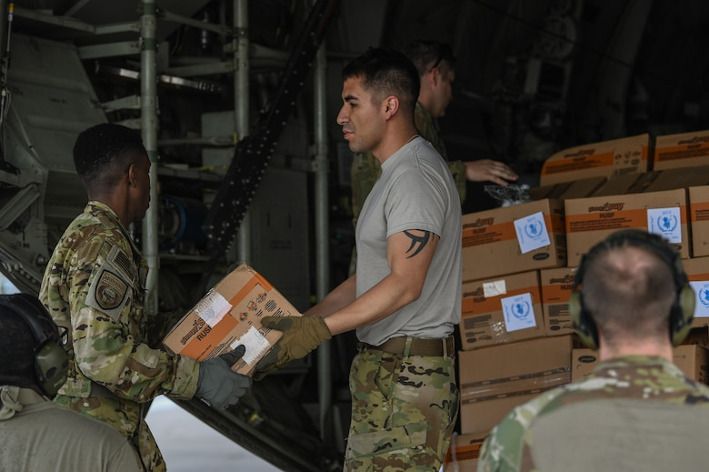 U.S. Airmen assigned to the 75th Expeditionary Airlift Squadron, Combined Joint Task Force-Horn of Africa (CJTF-HOA), offload humanitarian aid from a C-130J Hercules at Beira Airport, Mozambique, April 2, 2019, for the U.S. Department of Defense's (DoD) relief effort in the Republic of Mozambique and surrounding areas following Cyclone Idai. Teams from CJTF-HOA, which is leading DoD support to relief efforts in Mozambique, began immediate preparation to respond following a call for assistance from the U.S. Agency for International Development's Disaster Assistance Response Team. (U.S. Air Force photo by Staff Sgt. Corban Lundborg)