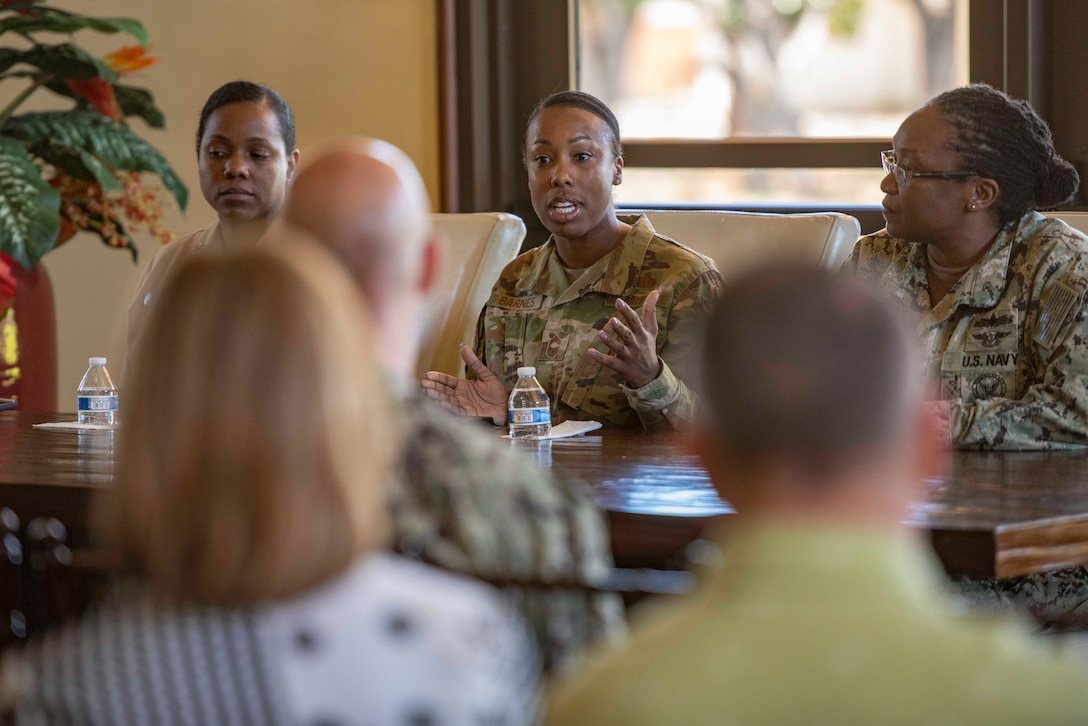 Chief Master Sgt. Jamesha Barnes, assigned to Headquarters, Readiness and Integration Organization Det. 2, speaks about her experiences as a female Airman during the Joint Base Pearl Harbor-Hickam Women's History Month observance panel. (U.S. Navy photo by Mass Communication Specialist 2nd Class Charles Oki/Released)