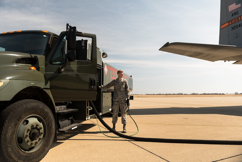 Airman operating refueling truck.