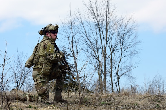 """Senior Airman Lucas Morrison, 148th Air Support Operations Squadron, 193rd Special Operations Wing, participates in a Tactical Combat Casualty Care Field Training Exercise April 6, 2019, at Fort Indiantown Gap, Annville, Pennsylvania. Morrison and fellow Airmen participating in the FTX completed three different timed scenarios in which they moved tactically through a series of unpredicted """"ambushes."""" (U.S. Air National Guard photo by Staff Sgt. Rachel Loftis)"""