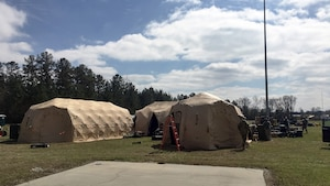 Exterior photos of tents at exercise location.