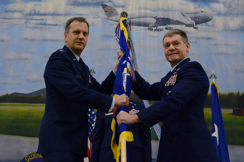 Maj. Gen. Randall A. Ogden, Air Force Reserve Command 4th Air Force commander, passes the 439th Airlift Wing guidon to Col. Craig C. Peters, the new 439th Airlift Wing commander, during a change of command ceremony, April 6, 2019, Westover Air Reserve Base, Mass. Though officially Peters won't assume command until April 14, the ceremony was held in advance in order to coincide with a Unit Training Assembly, when the majority of reservists are on duty. (U.S. Air Force photo by Senior Airman Hanna Smith/Released)