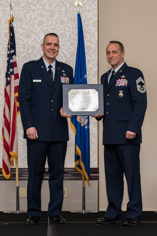 U.S. Air Force Maj. Nicolas Megyesi, left, presents Chief Master Sgt. Karl Fourroux, security forces manager, 932nd Airlift Wing, the certificate of retirement at his retirement ceremony on April 6, 2019, Scott Air Force Base, Illinois. Citizen Airmen Chief Fourroux retired after honorably serving for 34 years.  (U.S. Air Force photo by Senior Airman Brooke Deiters)
