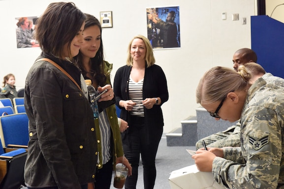 Military spouses affiliated with the 193rd Special Operations Wing, Middletown, Pennsylvania, check in for a spouse orientation flight aboard an EC-130J Super J aircraft April 7, 2019. There were 15 spouses that participated in this orientation flight. (U.S. Air National Guard photo by Staff Sgt. Julia Sorber/Released)