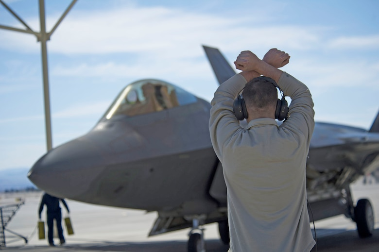 Through Total Force Integration at Nellis, Reserve aircraft maintainers work side by side with active-duty providing skilled manpower and continuity to accomplish the U.S. Air Force Warfare Center mission.