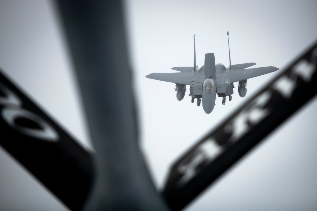 A U.S. Air Force F-15E Strike Eagle assigned to the 492nd Fighter Squadron at RAF Lakenheath, England, approaches a KC-135 Stratotanker from the 100th Air Refueling Wing, RAF Mildenhall, England, to receive fuel over Scotland during exercise Joint Warrior 19-1, April 4, 2019. Joint Warrior is hosted by the U.K. biannually and aims to allow NATO forces to conduct joint operations in a complex environment, involving different military branches and units from different countries against a range of current and future threats. (U.S. Air Force photo by Tech. Sgt. Emerson Nuñez)