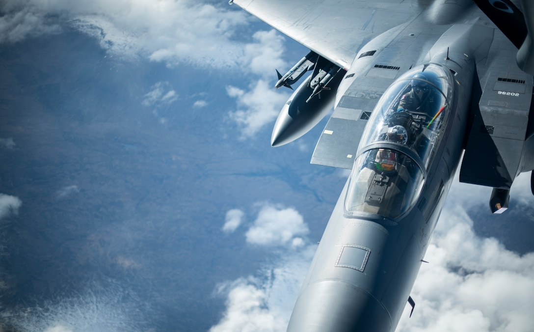 A U.S. Air Force F-15E Strike Eagle assigned to the 492nd Fighter Squadron at RAF Lakenheath, England, receives fuel from a KC-135 Stratotanker from the 100th Air Refueling Wing, RAF Mildenhall, England, over Scotland during exercise Joint Warrior 19-1, April 4, 2019. Joint Warrior is a U.K.-led multinational exercise that involves numerous warships, aircraft, marines and troops. (U.S. Air Force photo by Tech. Sgt. Emerson Nuñez)