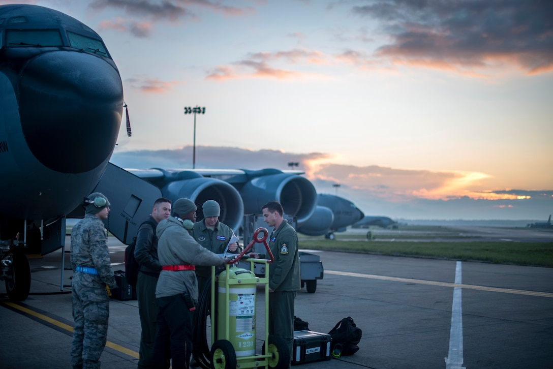 U.S. Air Force aircrew from the 351st Air Refueling Squadron and crew chiefs from the 100th Aircraft Maintenance Squadron review a pre-flight checklist together prior to a flight supporting exercise Joint Warrior 19-1 at RAF Mildenhall, England, April 4, 2019. Joint Warrior is a U.K.-led multinational exercise that involves numerous warships, aircraft, marines and troops. (U.S. Air Force photo by Tech. Sgt. Emerson Nuñez)