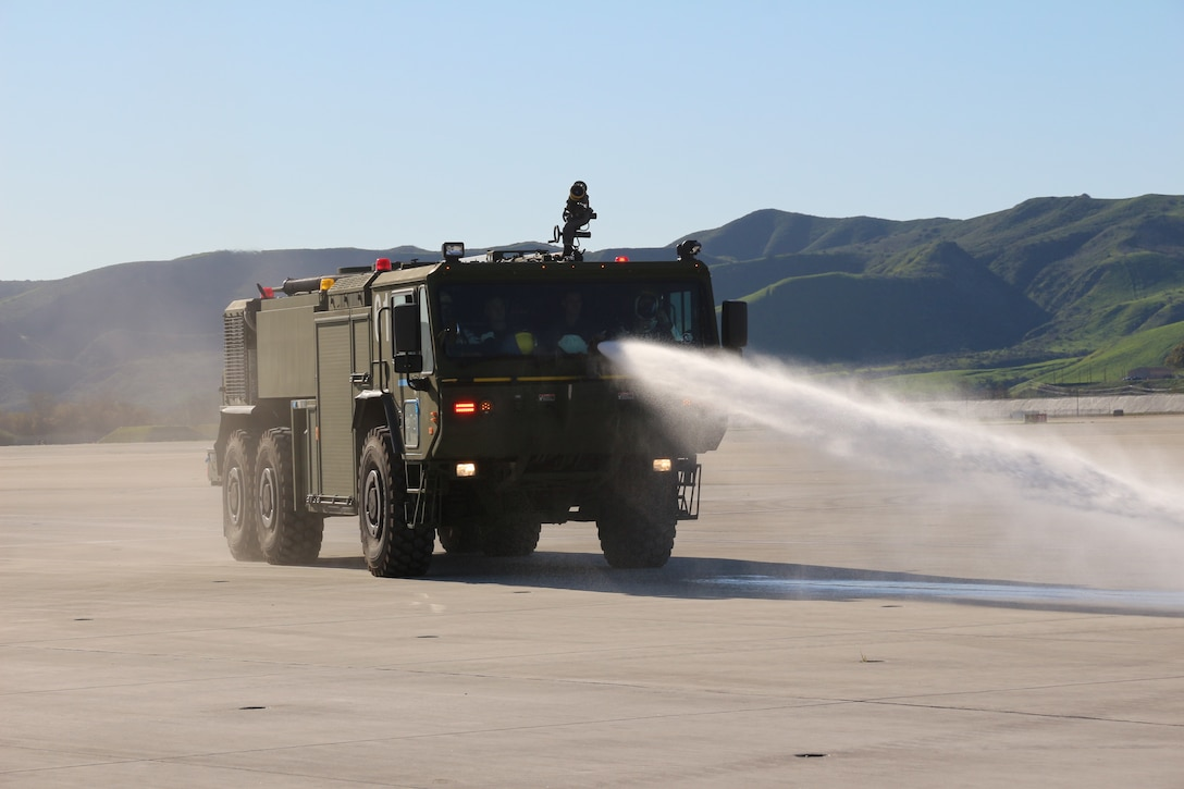 Aircraft Rescue and Fire Fighting Marines spray water from the bumper turret on the P-19R during an exercise aboard Marine Corps Air Station Camp Pendleton, Calif, in February 2019. Program Executive Officer Land Systems is currently fielding the P-19R to Marines worldwide. (U.S. Marine Corps photo by Ashley Calingo)