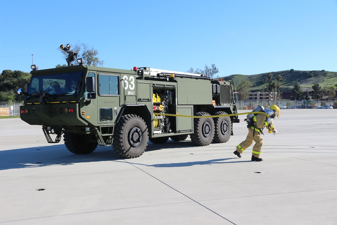 Aircraft Rescue and Fire Fighting Marines use a P-19R to respond to an incident during an exercise aboard Marine Corps Air Station Camp Pendleton, Calif, in February 2019. Program Executive Officer Land Systems is currently fielding the P-19R to Marines worldwide. (U.S. Marine Corps photo by Ashley Calingo)