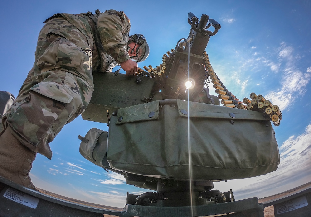Army Reserve Staff Sgt. Shane Seleznoff, a Stryker vehicle commander and native of Forney, Texas, assigned to 1st Reconnaissance Platoon, 360th Chemical Company, 468th Chemical Battalion, 209th Regional Support Group, 76th Operational Response Command, loads ammunition into a M2 .50 caliber machine-gun before heading downrange to qualify on crew-served platform gunnery as part of Operation Gauntlet at Fort Riley, Kansas, April 2. More than 450 Army Reserve Soldiers from around the country are participating in the three-week gunnery exercise to hone crucial gunnery skills and increase battlefield lethality. (Official U.S. Army Reserve photo by Sgt. 1st Class Brent C. Powell)
