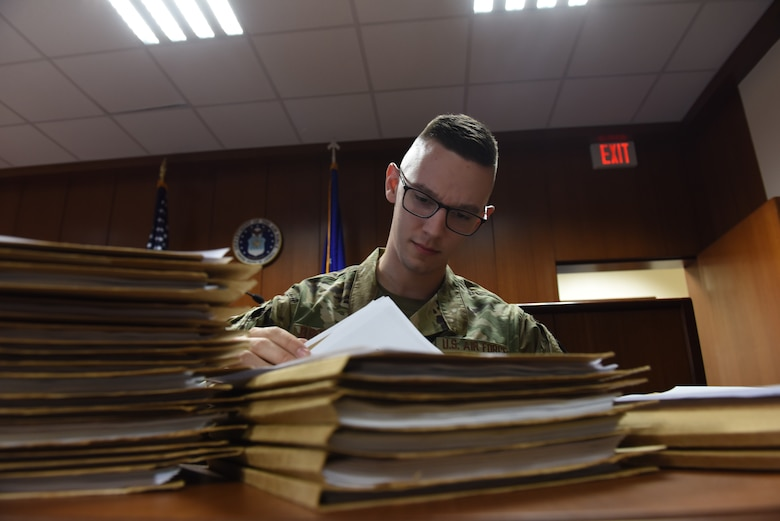 Senior Airman Mark Brownlee, 39th Air Base Wing military justice paralegal, reviews legal documents prior to a Judge Advocate Inspection March 11, 2019, at Incirlik Air Base, Turkey.