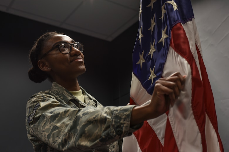 Staff Sgt. Ebony Rivera, 39th Air Base Wing protocol NCO in charge, demonstrates how to properly prepare the U.S. flag March 14, 2019, at Incirlik Air Base, Turkey.